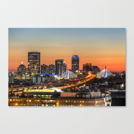 The Boston Skyline lit up blue at Sunset Canvas Print