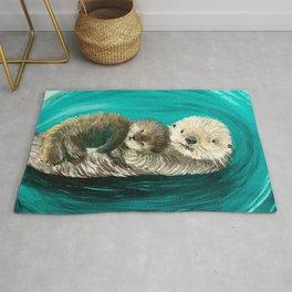 Cuddling Mama and Baby Sea Otters Rug
