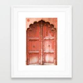 Ancient red wooden door in Agra, Uttar Pradesh, India Framed Art Print