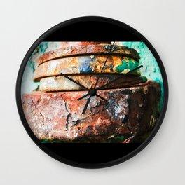 mixed metal race to cake Wall Clock