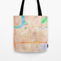 alabama Tote Bags featuring Montgomery, Alabama by Emily Day