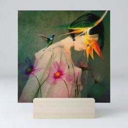 Woman between flowers / La mujer entre las flores Mini Art Print