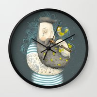 wesley bird Wall Clocks featuring Bird by Seaside Spirit