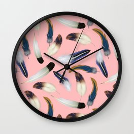 Pattern with feathers on a pink background Wall Clock