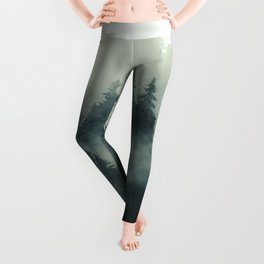 Misty pine forest on the mountain slope in a nature reserve Leggings
