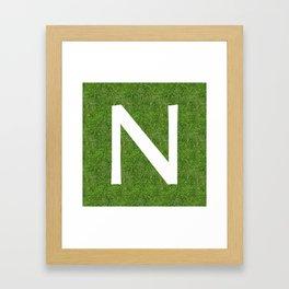 N initial letter alphabet on the grass Framed Art Print