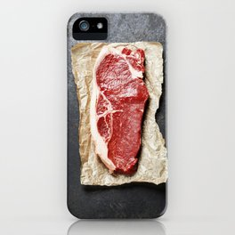 Raw beef steak on a dark slate background iPhone Case
