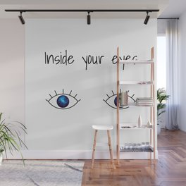Galaxy inside big blue eyes with text above Wall Mural