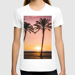 Orange bright sunset at the beach between palms T-shirt