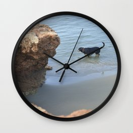 Dog on the beach Wall Clock