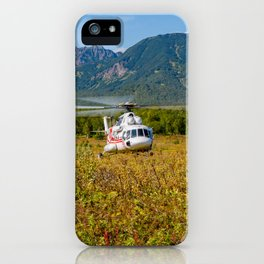 Helicopter landed in an autumn landscape iPhone Case