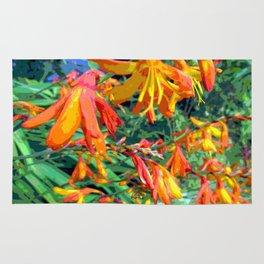 Crocosmia orange flowers Rug