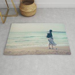 Woman on the beach Rug