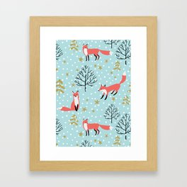 Red foxes in the blue winter forest with snow Framed Art Print