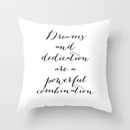 Dreams and dedication are a powerful combination. Throw Pillow