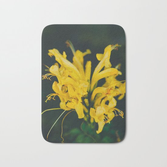 Beautiful yellow flower on black background Bath Mat