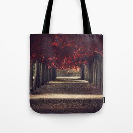 Red colors of autumn, surreal photo, red trees, alley in a park Tote Bag