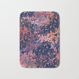 blanket of foliage in warm tones Bath Mat