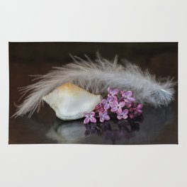 Still life with flowers, shell and feather Rug