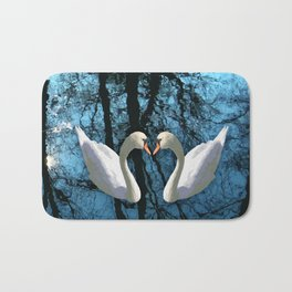 Swans and reflection Bath Mat