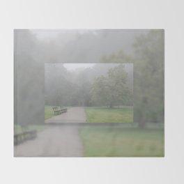 Gloomy autumn fog in park Throw Blanket