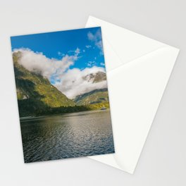 Spectacular mountain range surrounded by clouds close to sunset at Milford Sound Stationery Cards