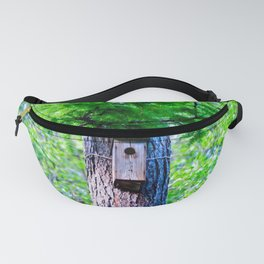Old Bird House On A Large Larch Tree In Spring. Fresh Green Leaves And Needles Fanny Pack