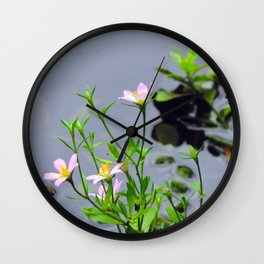 Flowers at the river bank Wall Clock
