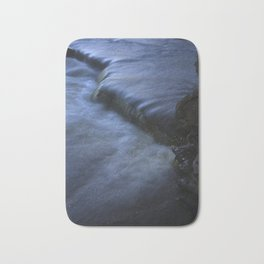Sparkling Blue Water Slips Past Gnarled Tree Roots Bath Mat