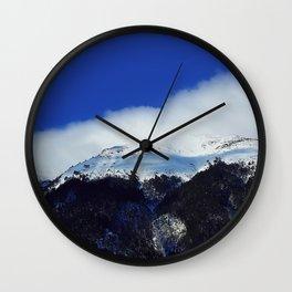 underneath a blue sky Wall Clock
