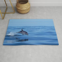 Spotted dolphin jumping in the Atlantic ocean Rug