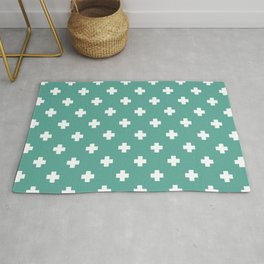 White Swiss Cross Pattern on Green Blue background Rug
