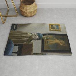 Johannes Vermeer - Lady Standing at a Virginal Rug
