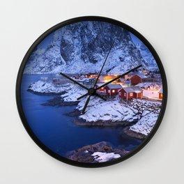Norwegian fisherman's cabins on the Lofoten at dawn in winter Wall Clock
