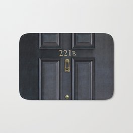 Haunted black door with 221b number Bath Mat