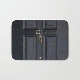 Haunted black door with 221b number Bath Mat
