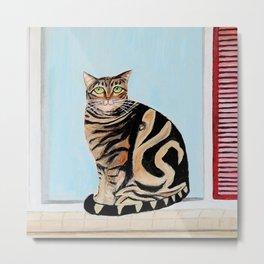 Cat sitting on window sill Metal Print