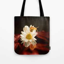 Baby Snail on a flower in the water  Tote Bag