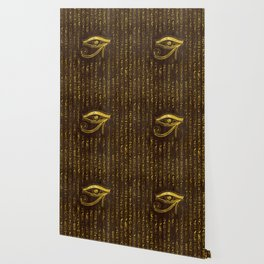 Golden Egyptian Eye of Horus  and hieroglyphics on wood Wallpaper