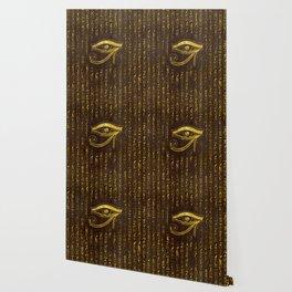 Golden Egyptian Eye of Horus  and hieroglyphics on wood Wallpaper