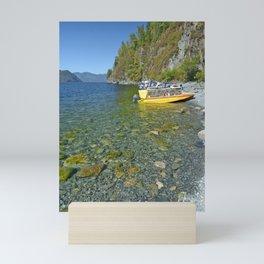 motor boats on the shore of a mountain lake Mini Art Print