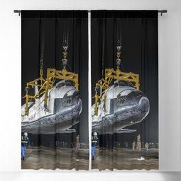 The space shuttle Discovery suspended from a sling held by two cranes Blackout Curtain