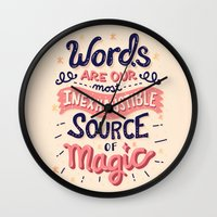 risa rodil Wall Clocks featuring Source of Magic by Risa Rodil