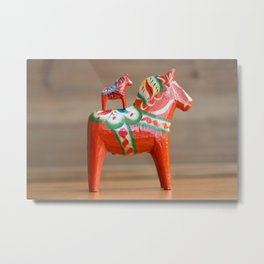 One large Dala horse with a small one on top of it Metal Print