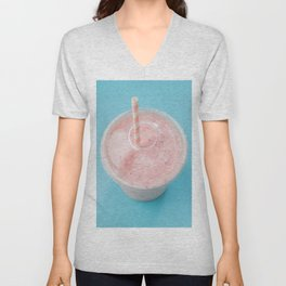 Top view of a strawberry smoothie in a plastic cup with a straw on a blue background. Unisex V-Neck