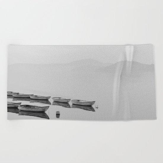 Small boat lake black white Beach Towel