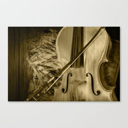 Cello Stringed Instrument with Sheet Music and Bow in Sepia Tone Canvas Print
