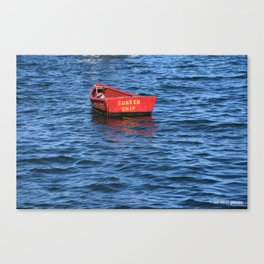 red row boat on blue water Canvas Print