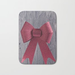 Big red Christmas shiny bow on a wooden background Bath Mat