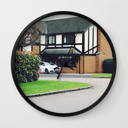 Luxury residential house with green hedge and landscaping in front. Wall Clock